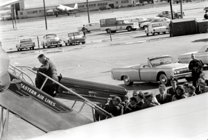 """The Decoy Ambulance When the First Lady arrived at the Bethesda Naval Hospital at about 6:55-7:05 p.m., November 22, 1963-- she arrived at the front of the building with a heavily guarded casket that was actually empty. Another navy ambulance had arrived earlier, which was driven by a man in a white surgical smock. That driver was Admiral Galloway. It pulled up at the rear of the building, and a greyish-pink shipping casket was unloaded. In Dallas the president was tenderly wrapped in a white linen shroud and placed in a bronze ceremonial casket. By the time Kennedy's body arrived in Bethesda it was in a cheap shipping casket, and wrapped in a body bag. The final, cruelest indignity was that Kennedy was stripped naked and bereft of his shroud when they unzipped the bag. You can imagine the surprise of the doctor falsely attributed with the original autopsy. At the Bethesda Naval Hospital, autopsy assistant Paul O'Conner could only describe Cmdr. James Joseph Humes as uncharcteristically """"scared to death"""" when he unzipped the body bag, looked into Kennedy's skull, and he saw no brain. Naturally. The brain contained evidence of trajectory and bullet fragments. """"Moreover, we know the identities of several of the individuals who were involved in the cover-up. These persons could be subpoenaed and finally asked tough, probing questions about their disgraceful behavior--and, if caught lying under oath, could be prosecuted for perjury. Who are these individuals? In my opinion, the list includes former WC counsels Arlen Specter and Wesley Liebeler, the three autopsy doctors, certain active and retired FBI agents and CIA officers, and former Dallas police lieutenant J. C. Day."""" From Preface; """"More than a Reasonable Doubt"""" by Michael Griffith"""