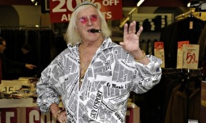 Jimmy Savile poses for the camera